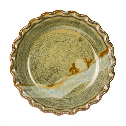 a shallow, green baking dish with a frilled edge