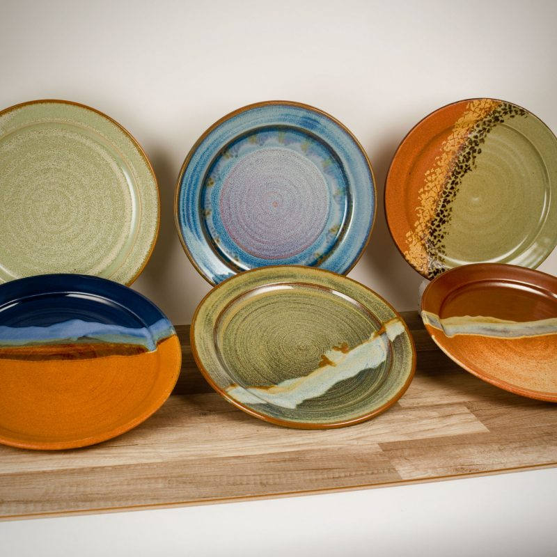 6 large, flat serving platters in assorted patterns.