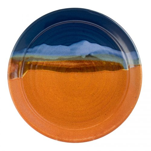 a large, blue and sandy brown serving platter