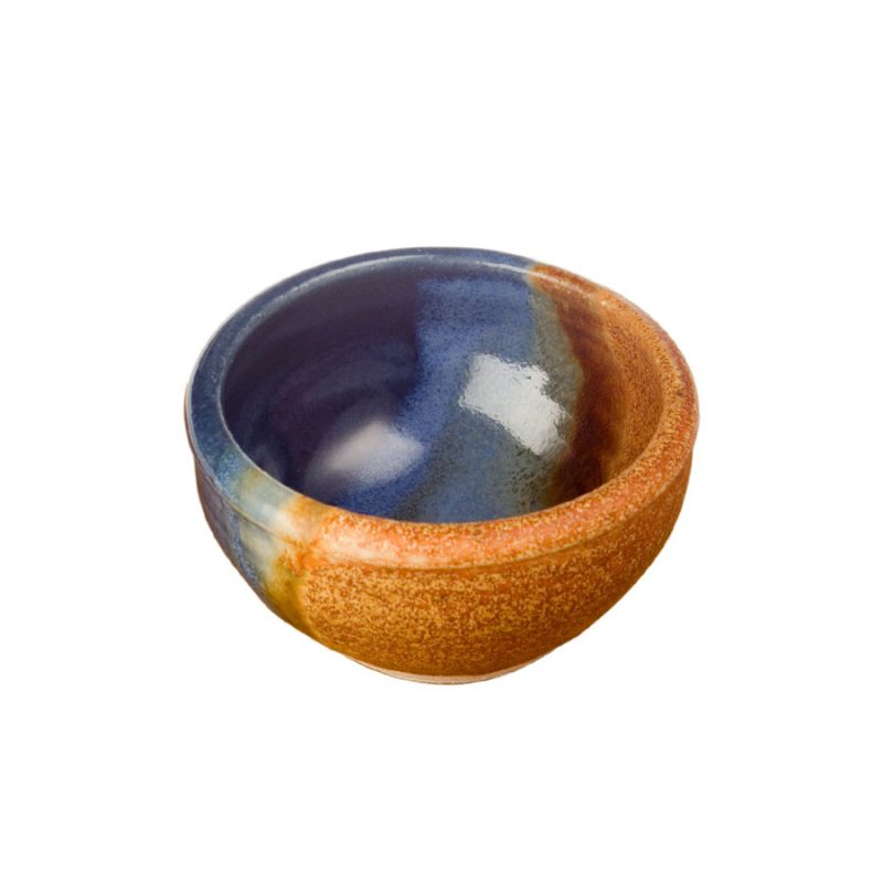 a petite, blue and sandy brown baking dish