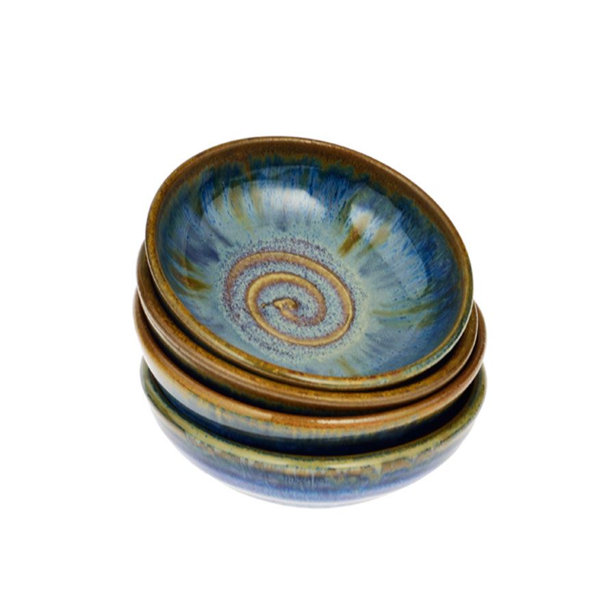 a set of petite, blue spice dishes