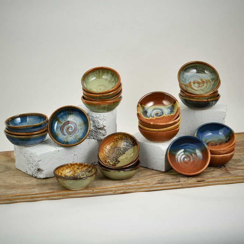 6 sets of small spice dishes, in assorted patterns.