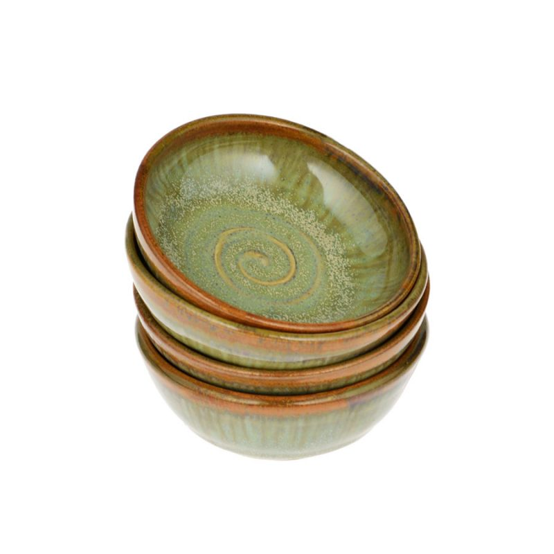 a set of petite, mint green spice dishes