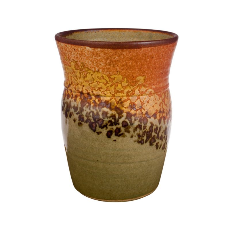 a tall, green and sandy brown storage jar