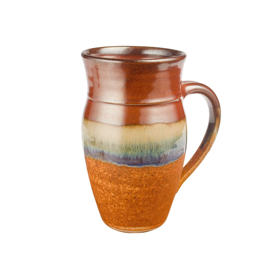 a large, red and sandy brown mug for beer or coffee