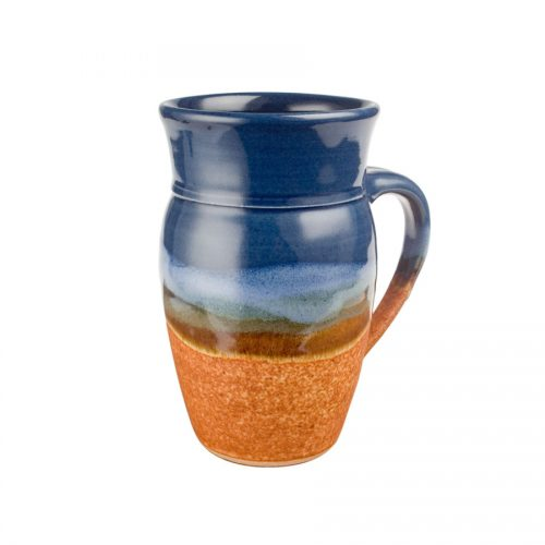 a large, blue and sandy brown mug for beer or coffee