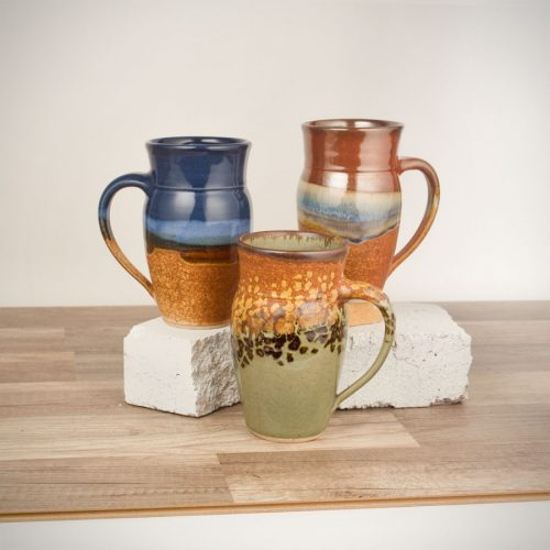 3 tall mugs for coffee or beer, in assorted patterns.