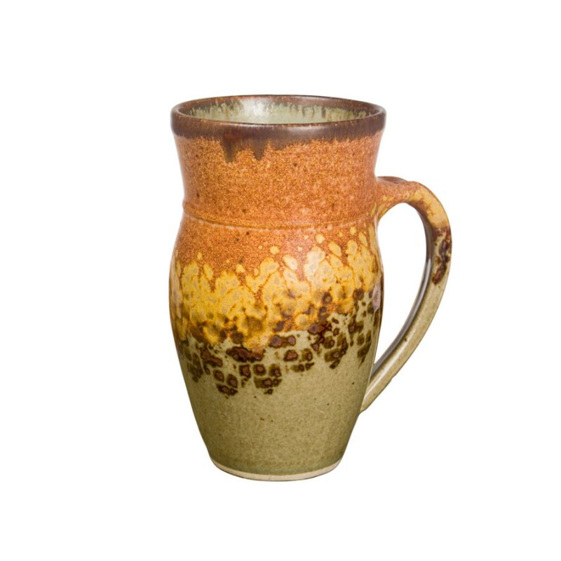 a large, green and sandy brown mug for beer or coffee