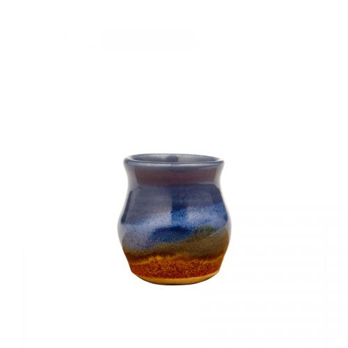 a petite, blue and sandy brown jar