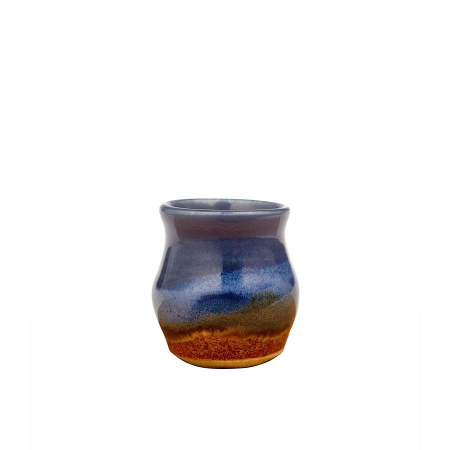 a petite, blue and sandy brown jar