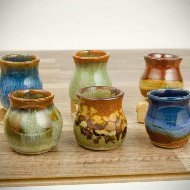 6 petite toothpick jars in assorted patterns.