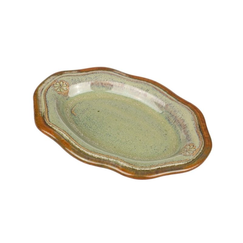 A small, handmade, mint green snack plate with a bronze colored rim.