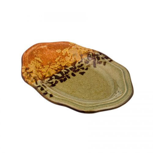 A small, handmade, green and orange snack plate with a black and gold animal printed band across the surface.