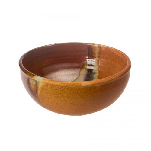 A small, red and sandy brown dinnerware bowl with rounded sides and a variegated blue band across the surface.