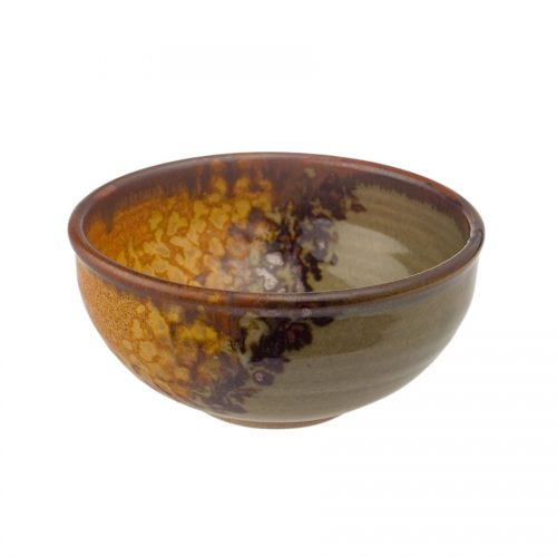 A small, handmade, green and sandy brown dinnerware bowl with rounded sides and a dark brown rim, featuring a black and gold animal print band across the surface.