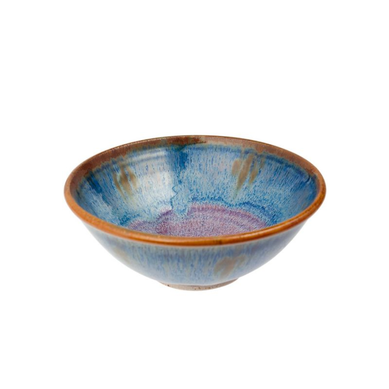 a petite, handmade, variegated blue dinnerware bowl with flared sides and a bronze colored rim.