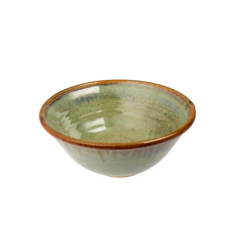 A petite, handmade, mint green dinnerware bowl with flared sides and a bronze colored rim.
