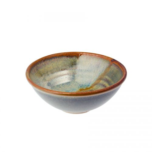 A petite, handmade, variegated green dinnerware bowl with flared sides and a bronze colored rim, featuring a light blue band across the surface.
