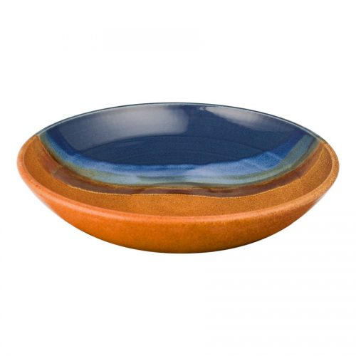 A shallow, handmade, blue and orange serving bowl with a pale blue band across a third of the piece.
