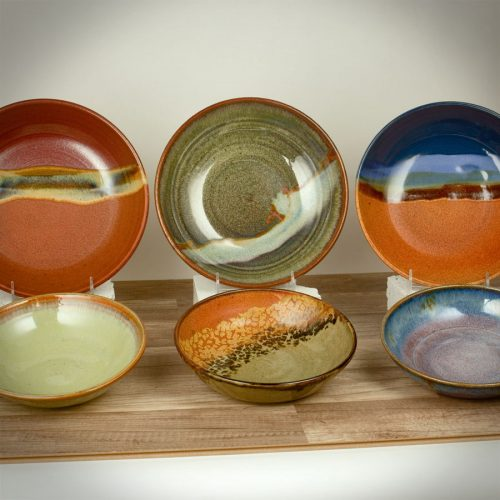 6 shallow bowls for pasta or salad in two different sizes and six different patterns.