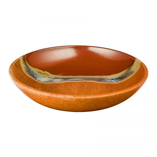 A shallow, handmade, red and orange serving bowl with a pale blue band across a third of the piece.