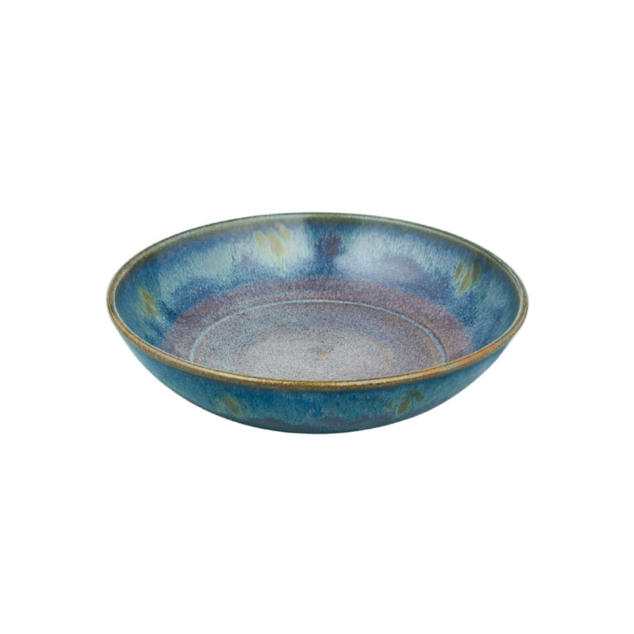 A small, shallow, handmade dinnerware bowl for pasta or salad. It is variegated blue with a bronze colored rim.