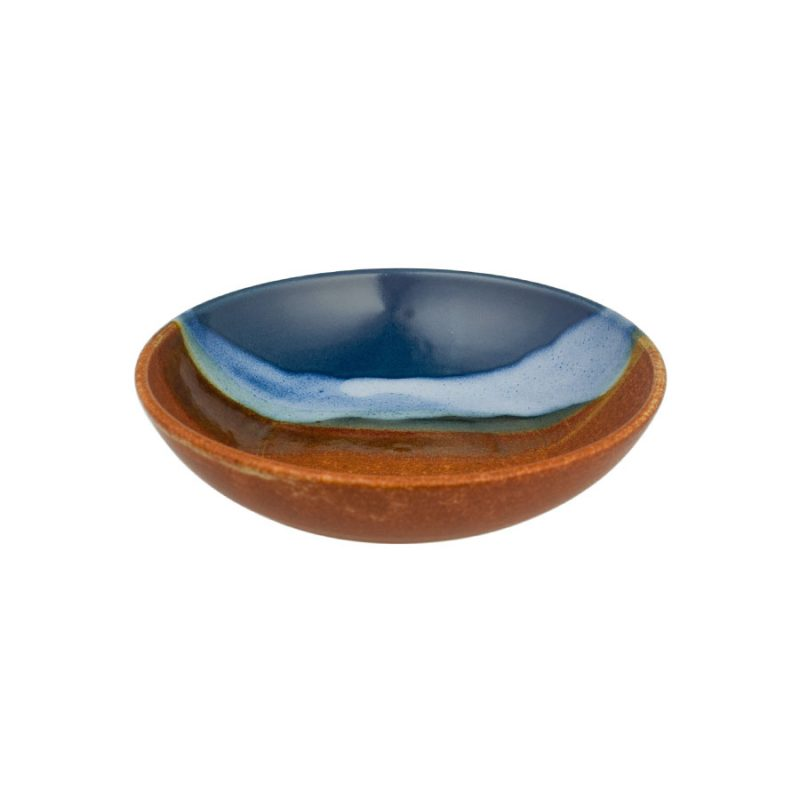 A small, shallow, handmade dinnerware bowl for pasta or salad. It is blue and orange with a pale blue band across a third of the pottery.