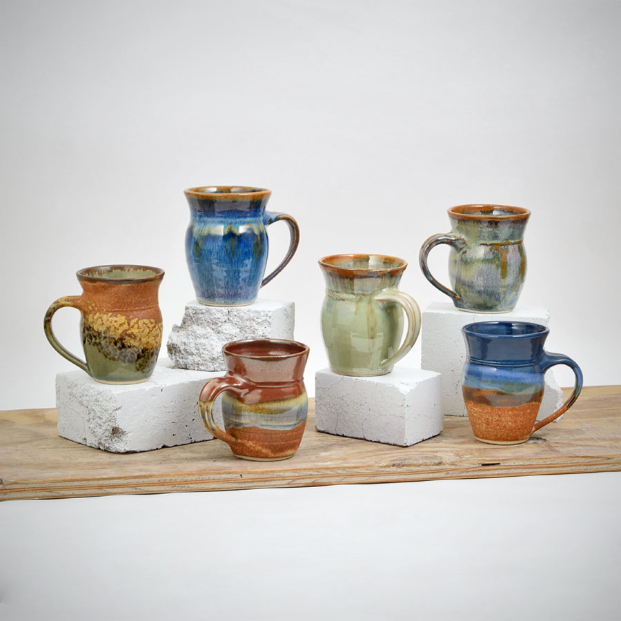 A group shot of six round bodied mugs in different patterns,.