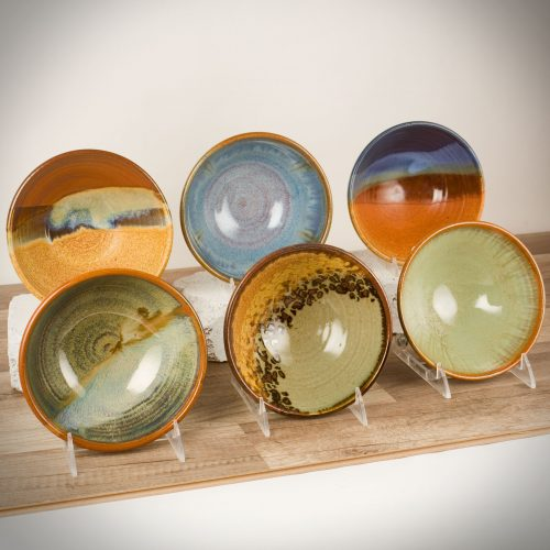 Six salad bowls with flared sides in assorted patterns.