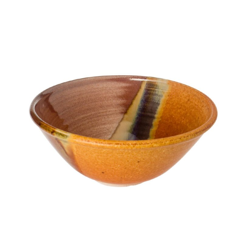 a small, handmade, red and orange salad bowl with flared sides and a variegated blue band across the surface.