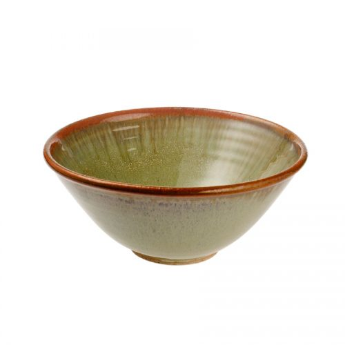 a small, handmade, frosted mint green dinnerware bowl with flared sides and a bronze colored rim.
