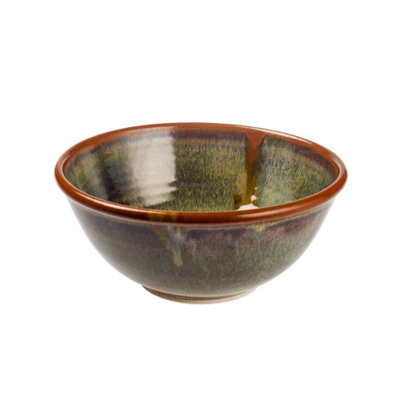 a small, handmade, variegated green dinnerware bowl with flared sides and a bronze colored rim, featuring a light blue band across the surface.