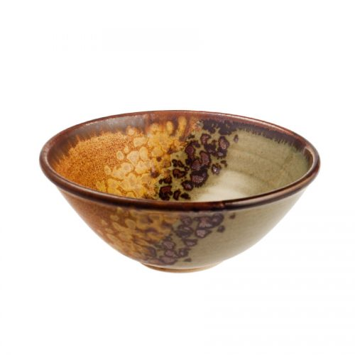 a small, handmade, green and orange dinnerware bowl with flared sides and a dark brown rim, featuring a black and gold animal print band across the surface.