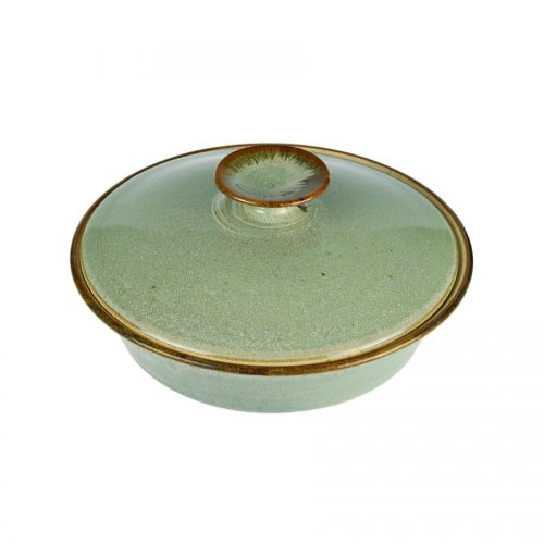 A shallow, handmade mint green dish with a lid for warming tortillas or bread.