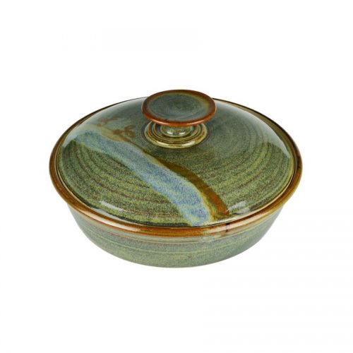 A shallow, handmade variegated green dish with a lid for warming tortillas or bread.