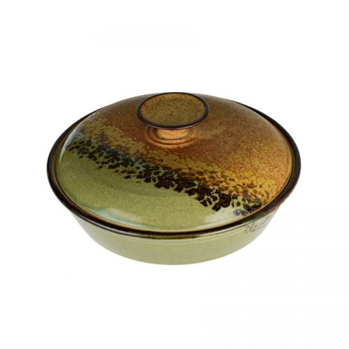 A shallow, handmade, green and orange dish with a lid for warming tortillas or bread.