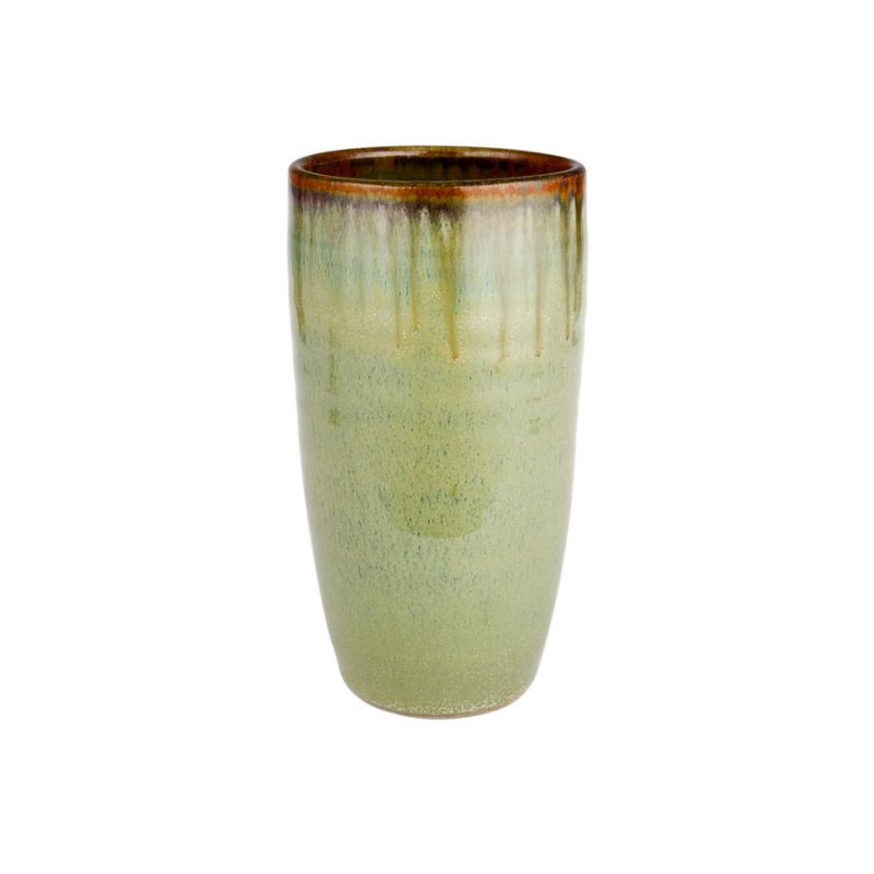 A tall, handmade, mint green drinking cup with a bronze colored rim.