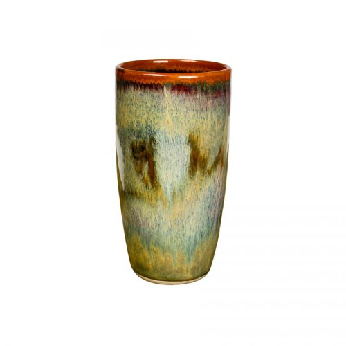 A tall, handmade, variegated green drinking cup with a bronze colored rim, featuring a light blue band across the surface.