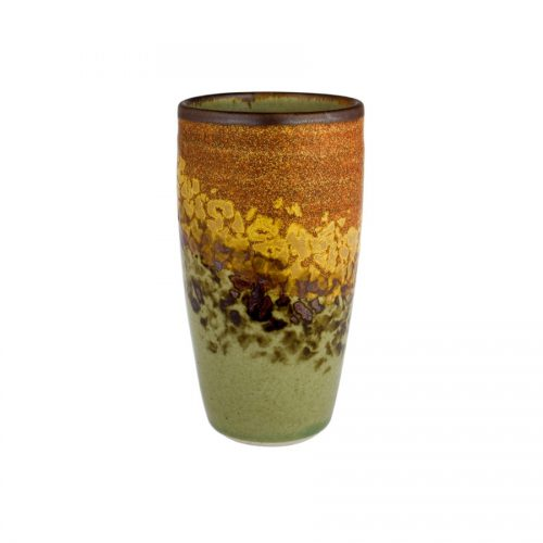 A tall, handmade, green and orange drinking cup with a dark brown rim, featuring a black and gold animal print band across the surface.