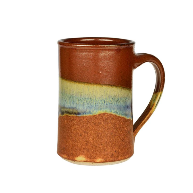 A handmade, red and orange coffee mug with straight sides and a variegated blue band across the surface.