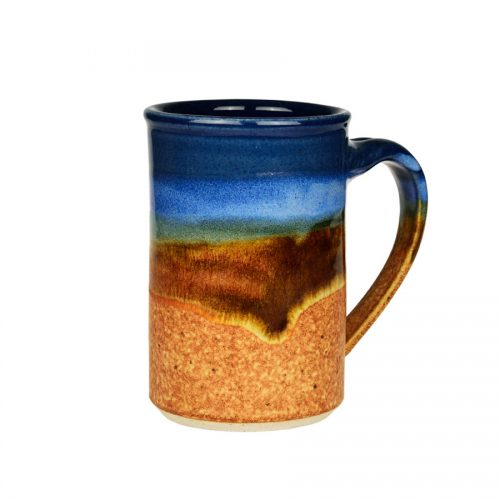 A handmade, blue and orange coffee mug with straight sides and a sky blue band across the surface.