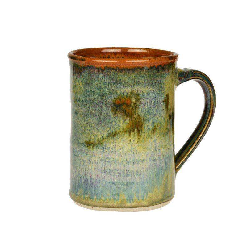 A handmade, variegated green coffee mug with straight sides and a bronze colored rim, featuring a light blue band across the surface.