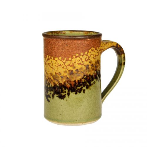 A handmade, green and orange coffee mug with straight sides and a dark brown rim, featuring a black and gold animal print band across the surface.