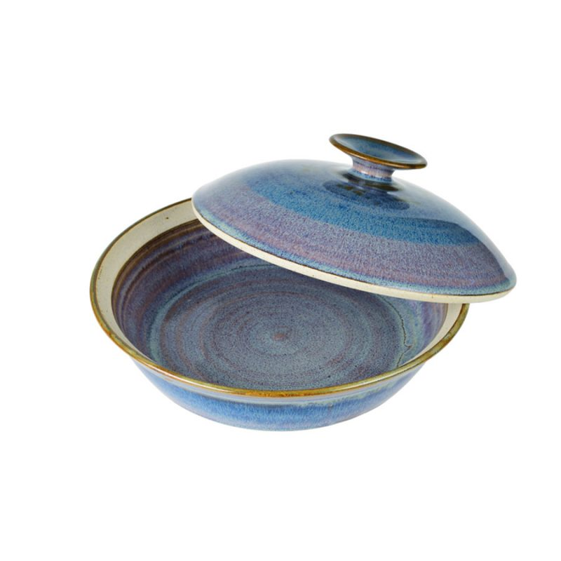 a shallow, handmade, variegated blue dish with a lid for warming tortillas or bread.