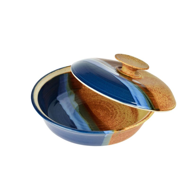 A shallow, handmade, blue and orange dish with a lid for warming tortillas or bread.