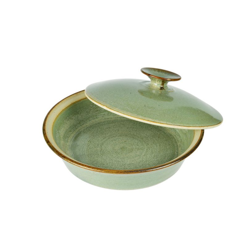 a shallow, handmade, frosted mint green dish with a lid for warming tortillas or bread,