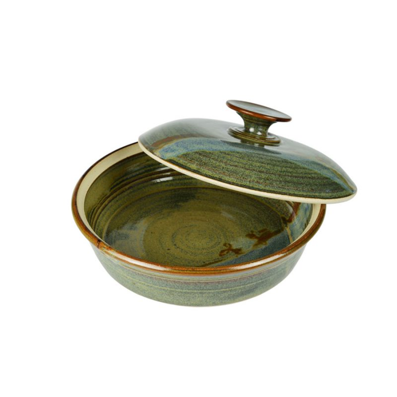 A shallow, handmade, variegated green dish with a lid for warming tortillas or bread.