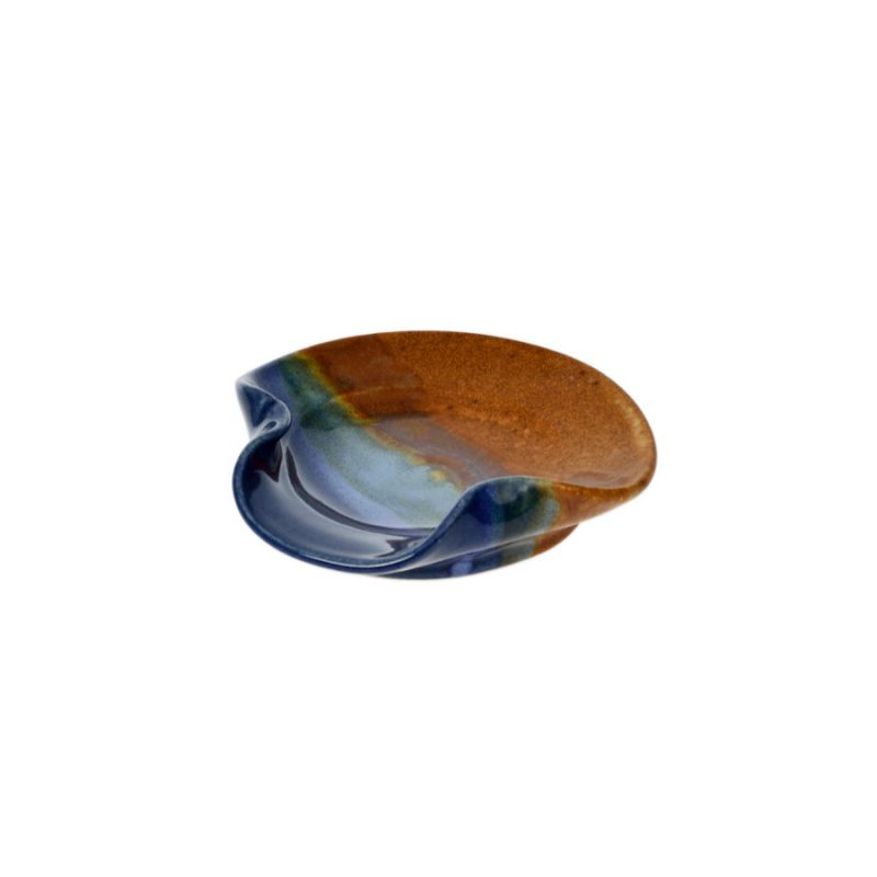 a petite, blue and sandy brown utensil stand