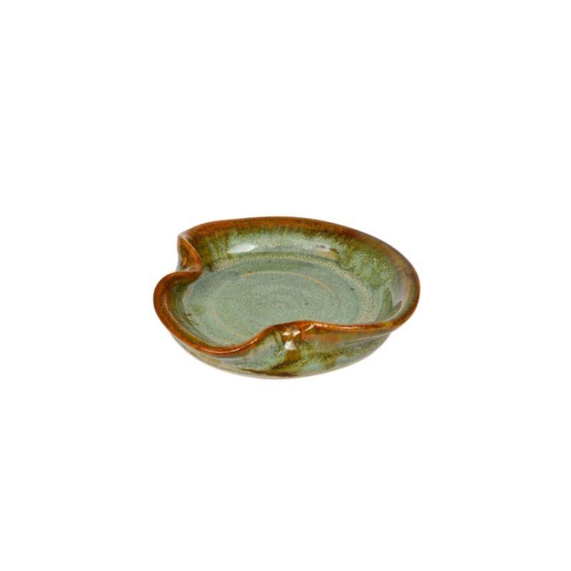 a petite, mint green utensil stand