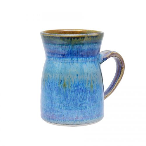 a handmade, variegated blue coffee mug with flared sides and a bronze colored rim.